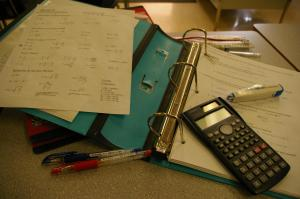 Papers, notebook & calculator