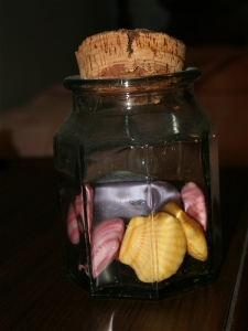 Glass jar of small soaps