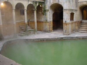 Ancient Roman bath with green water