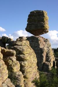 large square balancing boulder