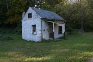 White abandoned shack