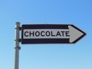 """Arrow street sign pointing right labeled """"chocolate"""""""
