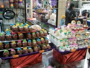 Store display of traditional sugar and chocolate skulls for Dia de Muertos