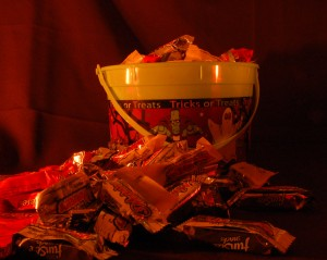 Bucket of trick or trat candy with more piled in front