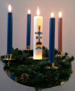 Advent wreath with center decorated Christ candle