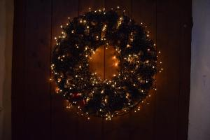 Wreath of greens lit with small lights