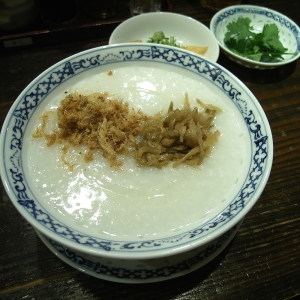 Bowl of rice congee with garnishes