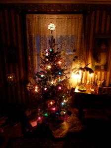 Lighted Christmas tree in a darkened room