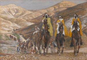 The Magi Journeying painting by James Tissot showing them in the desert hills on camels