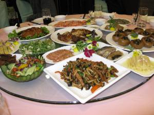 Round table covered with Chinese banquet dishes