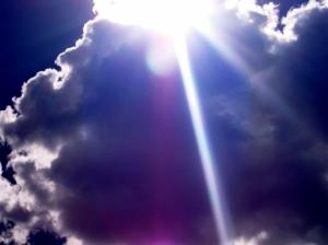 Bright white sunburst against deep blue sky