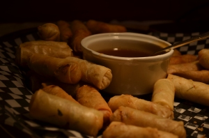 Plate of Hong Kong style spring rolls with dipping sauce