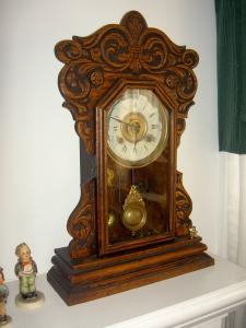 Ornate wooden mantel clock