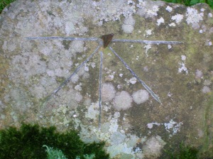 A sundial showing the four Tides and five Canonical hours, based on the example on the Bewcastle Cross.