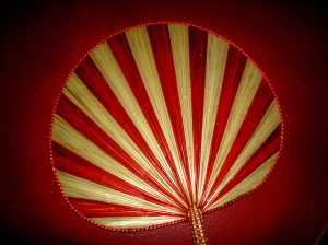 Red and white round hand fan