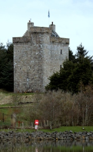 Stone castle tower surrounded by trees
