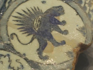 Tile of Leo from Islamic zodiac with sun visage rising over lion