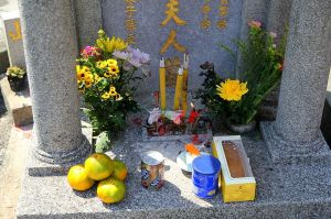 ecorated gravesite in Hong Kong cemetary with offerings for Double Ninth Festival