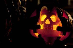Lit up pumpkin carved as skull