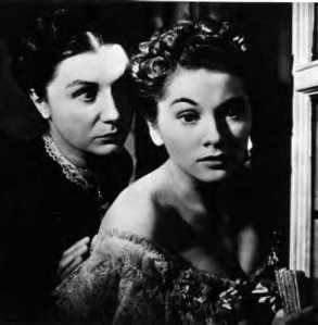 Judith Anderson and Joan Fonataine in a closeup from Rebecca