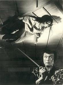 Black and white still from movie Yatsuyakaidan