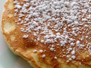 Close up of pancake covered in powdered sugar