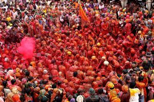 Red color drenched Gopis (cowherds) of Nandgaon at Holi