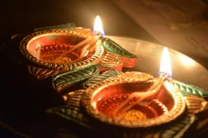 Pair of small Indian oil lamps lit for Diwali