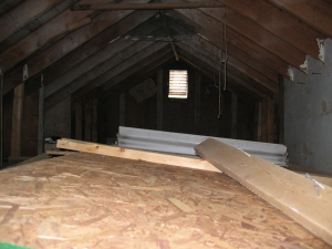 Empty attic with small window