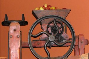 Old fashioned cider press with apples