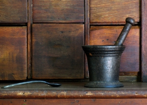 wooden apothecary drawers and mtal mortar and pestle